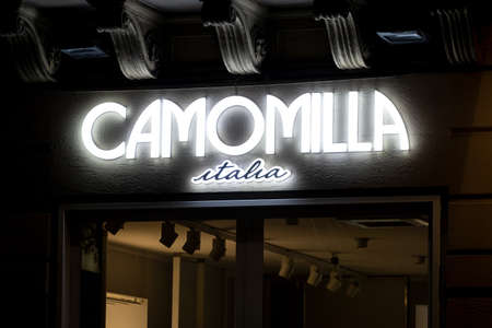PALERMO, SICILY - FEBRUARY 8, 2020: The illuminated logo of the Camomilla Italia boutique which sells the fashionable apparel for women