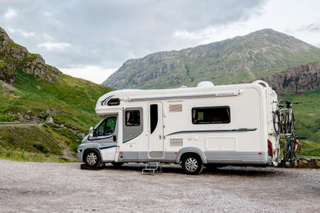 SCOTTISH HIGHLANDS, GREAT BRITAIN - AUGUST 2, 2019: Fiat Ducato Maxi caravan of the Motorhome Hire company parked in a bay for a short relax when travelling.