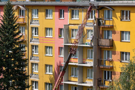 OSTRAVA, CZECHIA - AUGUST 19, 2019: Construction of new balconies on old block of flats in Czech Republic by the Straub company