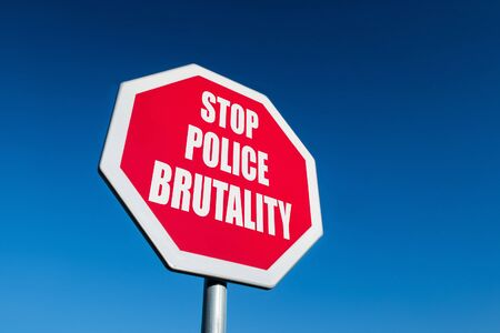 A traffic sign with the text STOP POLICE BRUTALITY to illustrate protest against murdering people by US policemen