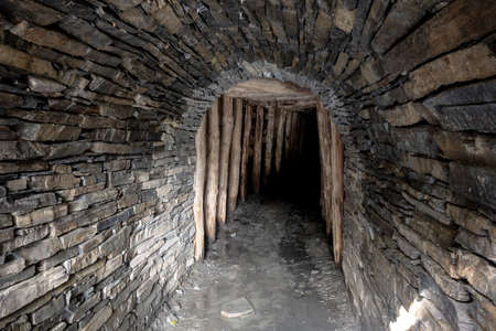 The entrance to the historical Flascharuv dul slate mine in Odry, Czech Republic with a dark corridor Banco de Imagens