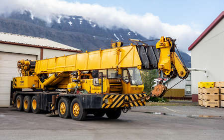 ISAFJORDUR, ICELAND - JULY 7, 2014: Grove TMS 475 crane vehicle with 5 axes parked in harbour in Isafjordur, Iceland Sajtókép