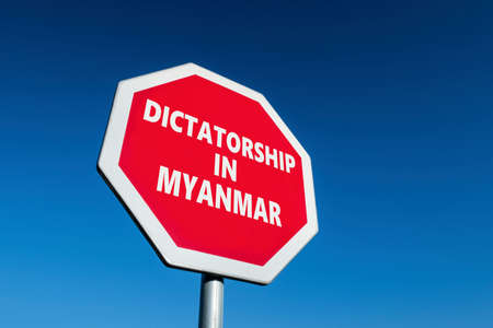 Stop sign with DICTATORSHIP IN MYANMAR known as Burma as well text to change the results of military coup in the country