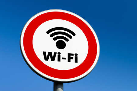 Red circle traffic sign forbidding the use of and other wireless communication technologies. Stock Photo