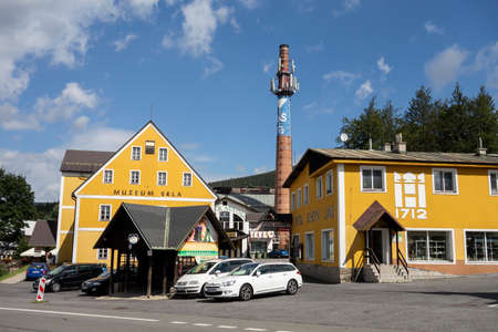 HARRACHOV, CZECH REPUBLIC - AUGUST 23, 2020: The building of Muzeum Skla - museum of glass in Harrachov with old chimney and Crystal Bohemia Land Sajtókép