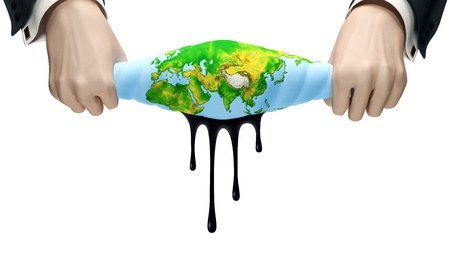 Hands squeeze out globe from which oil exudes