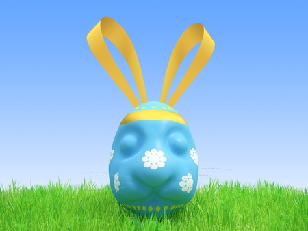 Easter blue egg in the form of a hare lies on a grass