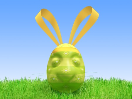 Easter green egg in the form of a hare lies on a grass