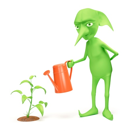waters: The green elf waters a plant Stock Photo