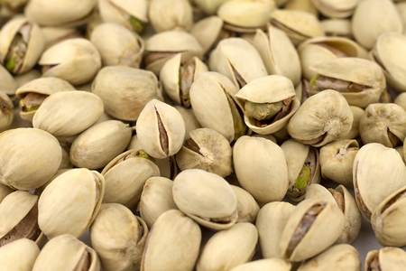 Nuts pistachios are not cleaned. Background, texture.