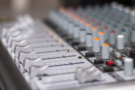 Audio mixing console. Knobs and controls on modern audio mixing console