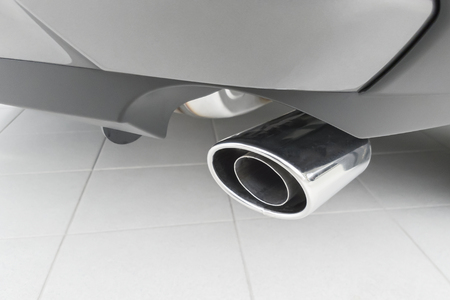 The car rear with the  chromeplated exhaust pipe.