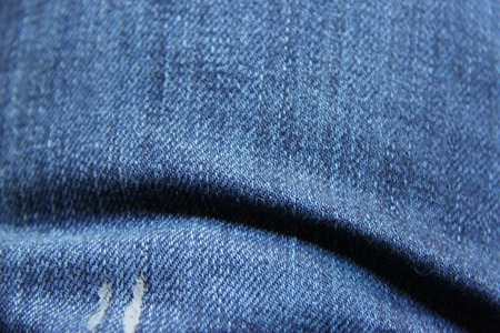 gathers: Jeans texture. Stock Photo