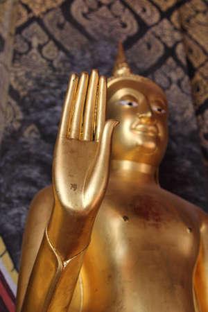 Golden buddha statue isolated Stock Photo