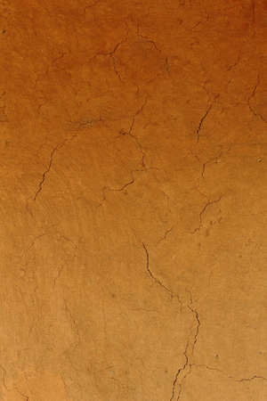 Old cracked wall made of orange clay and straw  Stock Photo