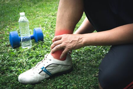 The man fill ankle or calf pain when he running exercise in a day time for sport, ้health concept.