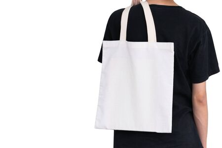 woman carry bag on white background in save earth concept or say no plastic bag. Archivio Fotografico