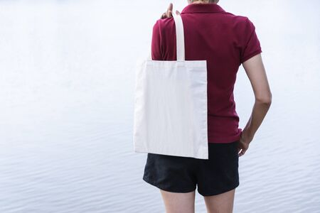 woman carry bag on nature background in save earth concept or say no plastic bag. Stock Photo