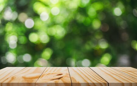 Wooden table in front and blur of nature background. 写真素材 - 129145329