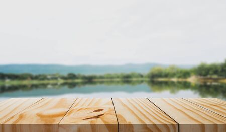 Wooden table in front and blur of nature background. 写真素材 - 129148857