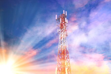 phone tower telecom it conveniently for mobile under the sky with sunshine. Stock Photo