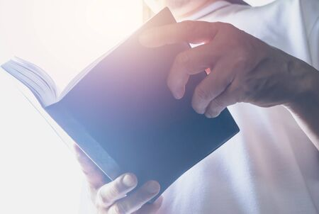 Man hold a book for reading to get knowledge. Stockfoto