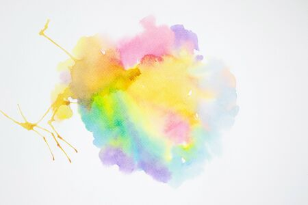 watercolor painting colorful splashing on white paper texture.