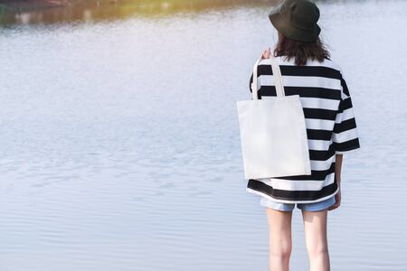 woman carry bag on nature background in save earth concept or say no plastic bag. 写真素材
