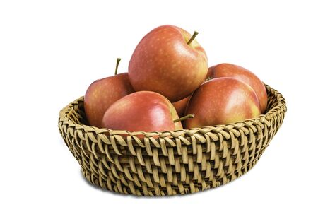 Group of apples in basket isolated on white background with clipping path.