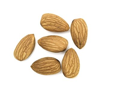 Top view flat lay almond isolated on white background. Фото со стока