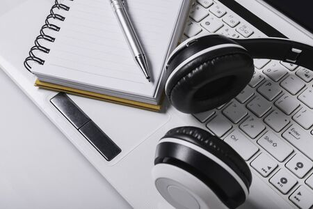 Top view headphones,book,pen,laptop on table is an online leaning concept. Фото со стока