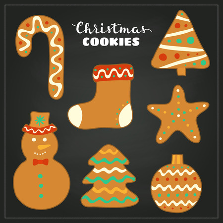 sweet treats: Doodle Christmas gingerbread cookies with icing isolated on the blackboard.