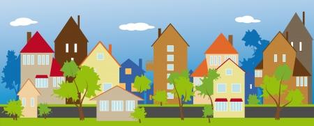 row of houses: Una calle tranquila y verde de un peque�o pueblo
