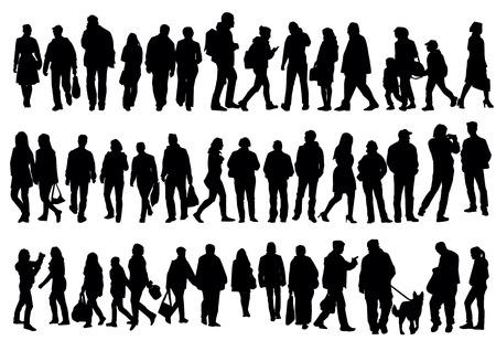 personas en la calle: Siluetas de la gente que camina en la calle