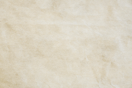 Crumpled powder recycled paper grunge texture.Light colored vintage paper background for design, web page with copy spice. Stock Photo