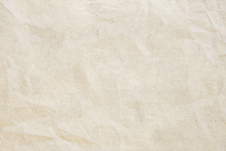 Crumpled powder recycled paper grunge texture. Light colored vintage paper background for design, web page with copy spice. Stock Photo