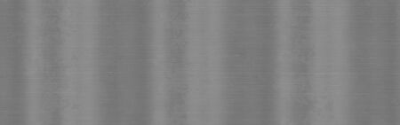 Brushed metal steel texture. Polished metal background with light reflection.