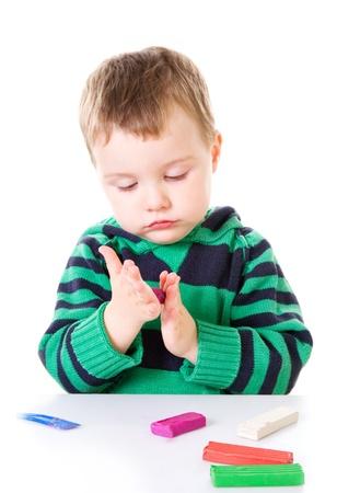Little boy with plasticine Stock Photo - 9027935