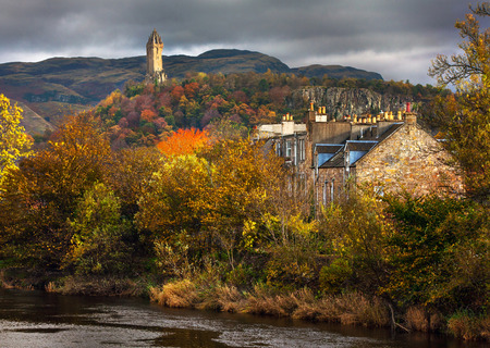 Colorful autumnal a view of William Wallace monument on a hill photo