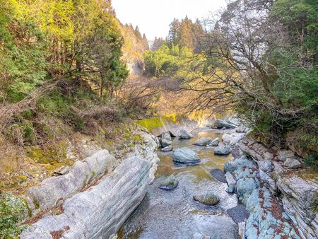 A mountain river in a valley deep in the mountains of Japan.