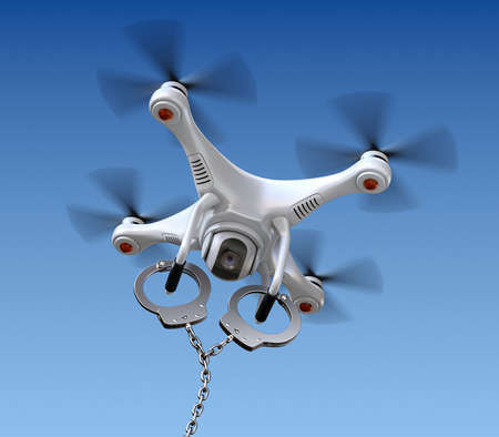 arrested: Quadrocopter drone with handcuffs Stock Photo