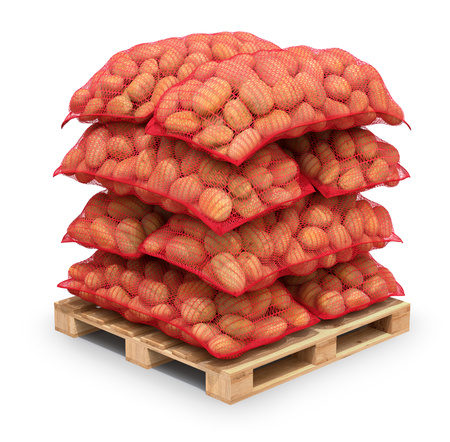 sacks: Potatoes in red burlap sacks on the pallet Stock Photo
