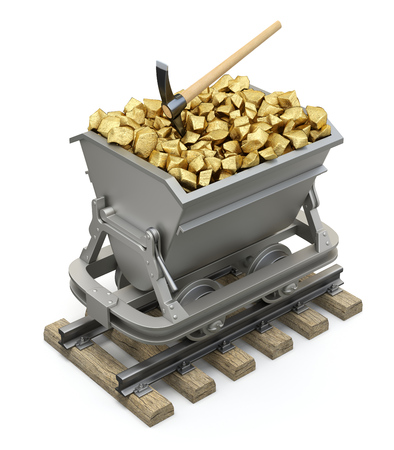 pick axe: Gold nuggets in the mining cart Stock Photo