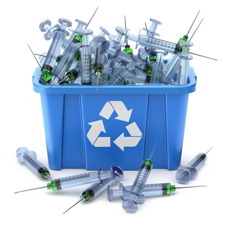 Syringes in blue recycle crate on white background - 3D illustration