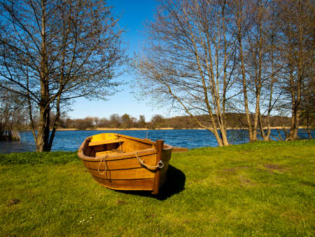 A boat dragged up on the ground close to the lake Svaneholmssjön i southern Sweden 版權商用圖片