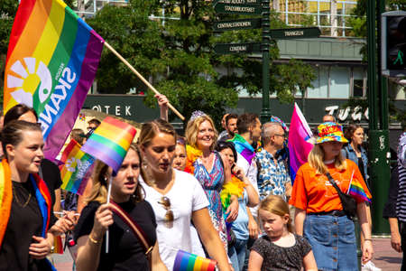 Malmö, Sweden - July 20, 2019: The head of development within Region SkÃ¥ne, Ulrika Geeraedts, is marching in the pride parade, waving a rainbow flag during the annual pride parade in Malmö, Sweden. Éditoriale