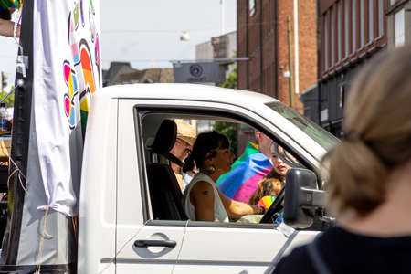 Malmö, Sweden - July 20, 2019: A woman driving a car through the crowds of the gay pride parade in the city center of Malmö, Sweden. Éditoriale