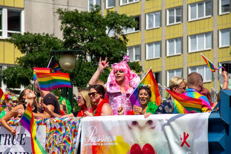 Malmö, Sweden - July 20, 2019: A float with lots of men and women partying, and in the middle a drag show artist dressed in pink is pumping her fist, during the annual pride parade in Malmö, Sweden. Éditoriale