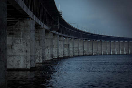 The concrete pillars holding up the Öresund bridge on a dark gloomy day by the sea in Malmö, Sweden