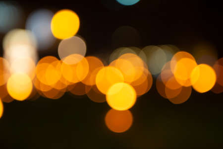 Yellow and orange bokeh effect from yellow lights outside